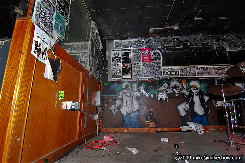 The Cobalt, September 27, 2009.<br /> <br /> The back of the stage. That big rectangular space on the back wall is where the Cobalt banner used to hang. You can see the duct tape from countless bands hanging their banners over it.