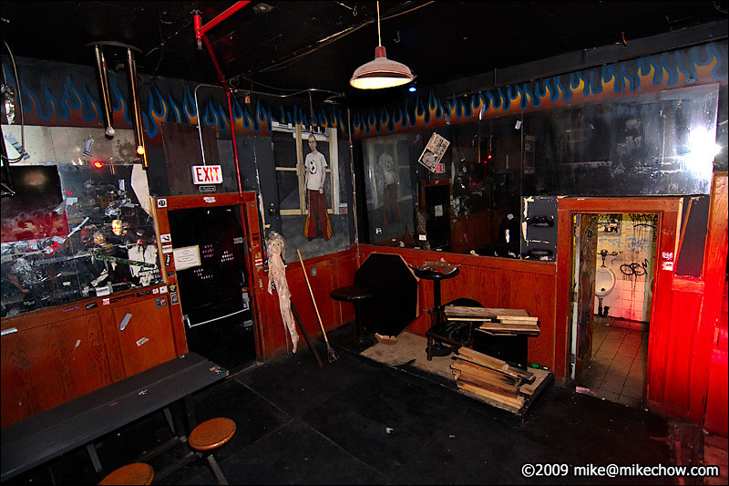 The Cobalt, September 27, 2009.<br /> <br /> The fire escape on the left and the men's washroom on the right. Normally there would be more art on the walls here, but most of it was taken down and I assume returned to its respective owners.<br /> <br /> Lucky for you at home, you can't smell the awful smell wafting from either of the two washrooms.