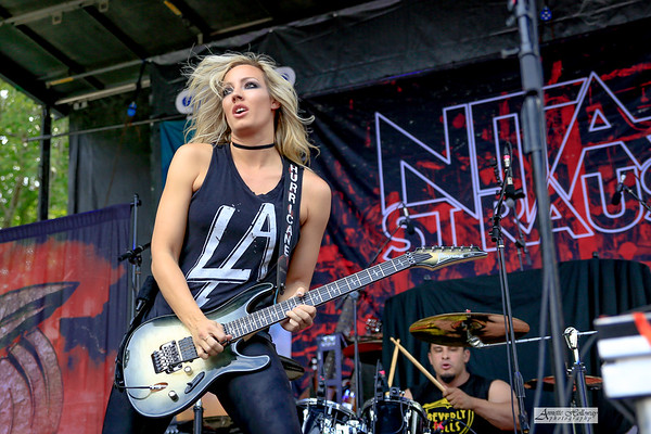 Nita Strauss and her band performing at Lunatic Luau in VA Beach on 8-17-19 © Annette Holloway Photography