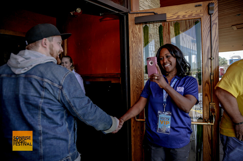 Trina Olson Keeny greeting B429's road manager, Hunter - SonRise Music Festival VIP Luncheon Friday 2-20-18 with Danny Gokey and Building 429