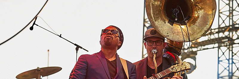 Delgres trio outdoor concert during Jazz à Juan Festival in Pinede Gould stage. July 2019. Leader Pascal Danaë (guitar and vocal), Baptiste Brondy (drums) and Rafgee (sousaphone)
