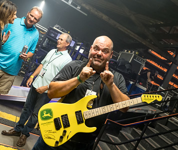 Guitar auctions raises $11,000 for Birdies for Charity.