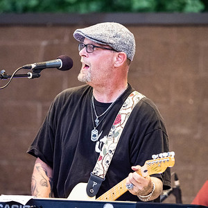 Pocket Change plays in Runners Park at The Freedom Run in East Moline, IL