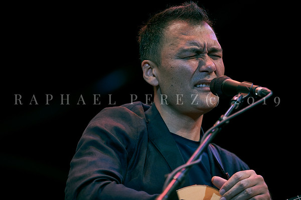 Chinese singer and guitar player with his band at Jazz à Jan Festival. July 2019 Singer &lead guitar: Ekram Kerim – Piano: Huang Jian Yi – Drums: Yu Guo Jun – Bass: Ren Yu Qing - Liu Xing – Vocal: Yikelamu Kelimu