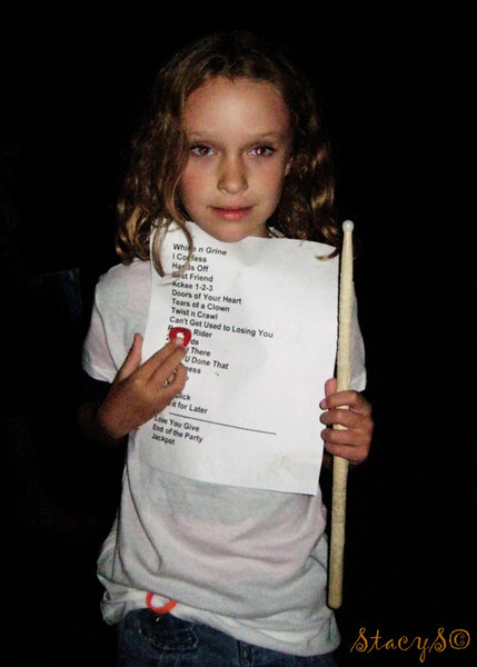 Skye with her mad lootz. Wayne's set list, a pick from Dave, and a stick from Rhythmm. (Thanks again, guys! You made her night!)