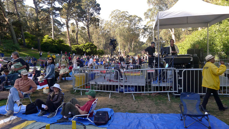 Light crowd and sound booth by the Rooster stage early in the day at Hardly Strictly Bluegrass Festival, 2012.