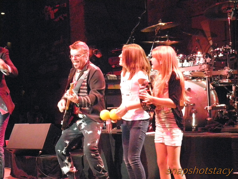Tim Farriss & the lucky little girls... Andrew hooked them up with some percussion!