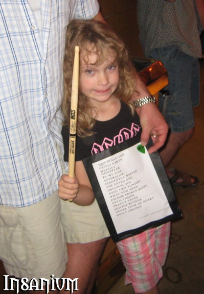 Skye with her awesome haul. Tim's set list, a pick from Garry, and one of Jon's sticks!