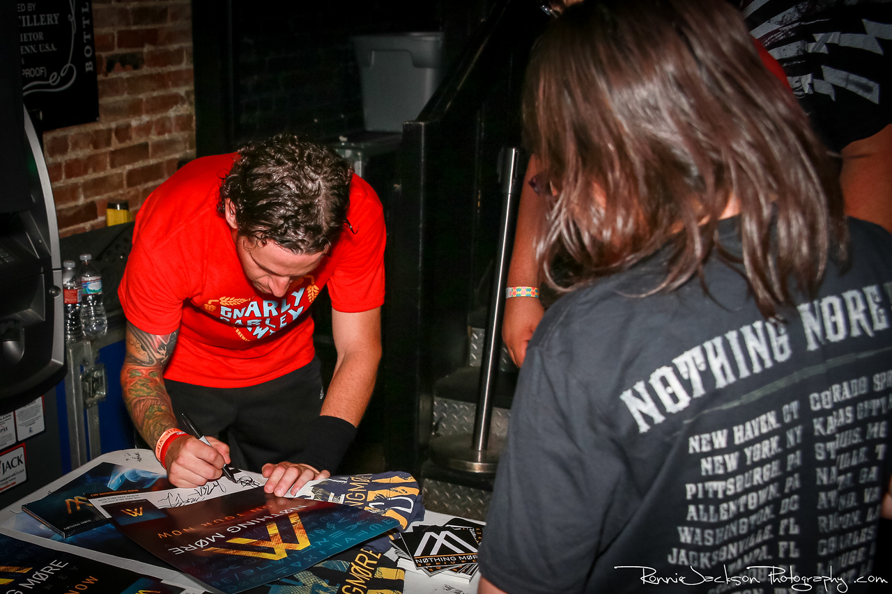 Paul Obrien of Nothing More signing a Poster for fans at Trees Dallas.  6-22-2013 © 2013 Ronnie Jackson Photography
