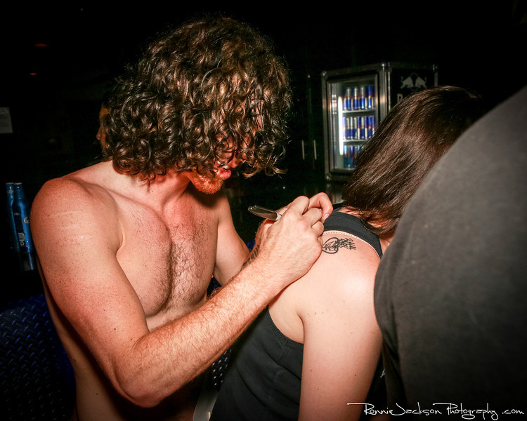 Jonny Hawkins of Nothing More signing a fans ticket at Trees Dallas.  6-22-2013 © 2013 Ronnie Jackson Photography