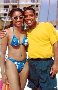 1997 Funk Festival in Aruba, host SINBAD. Reggie K. hands are full.