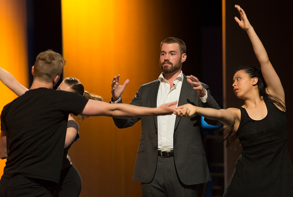 "Jake Alan Nelson recites Walt Witman's peom ""The Sleepers"" while performers dance around him at the Garden City High School Auditorium Tuesday. The performers are the ArtsFI group from New York."