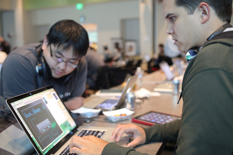 David and John work hard on Diode, their winning game from iOSDevCamp.