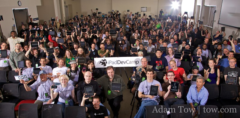 iPad owners and developers hold up their iPad during the inaugural iPadDevCamp in San Jose, California, on April 18, 2010.