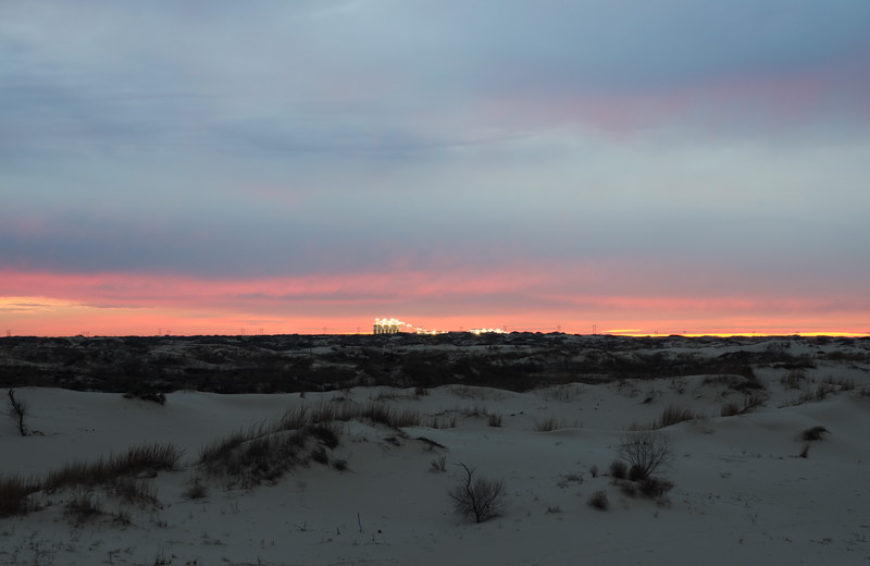 Pink Sunset Sky Above the Sand Dunes