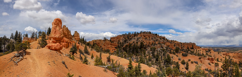 Panorama of Ridgeline Trail Passing by Red Rock Sandstone Formations on the Thunder Mountain Trail in Utah