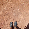 Mountain Biker's Mud Covered Legs and Shoes on Thunder Mountain Trail in Utah