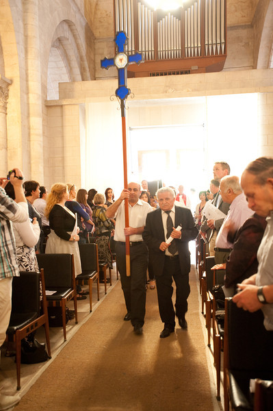 """The bright sun pours in as the doors to the Evangelical Lutheran Church of the Redeemer in the Old City of Jerusalem open to welcome the processional of local and international pastors gathered for the Ordination of Rev. Ashraf Tannous. ©  <a href=""""http://www.ryanrodrickbeiler.com"""">http://www.ryanrodrickbeiler.com</a>"""
