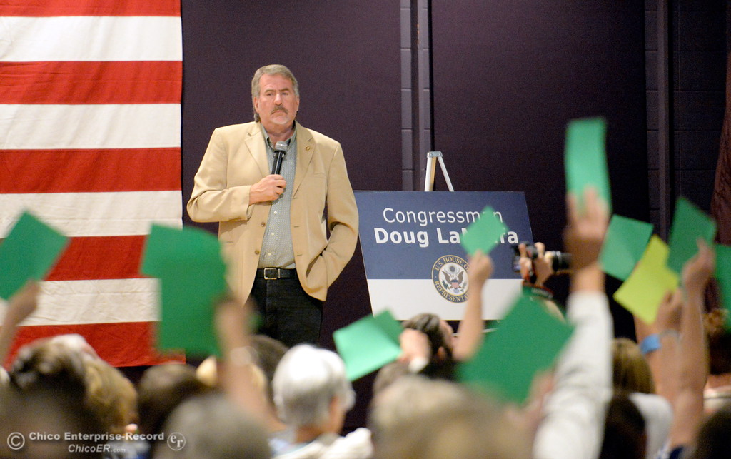 . Congressman Doug LaMalfa listens to comments and answers questions while people hold up signs to agree or disagree with what has been said during a Town Hall meeting held by Congressman Doug LaMalfa at the Elks Lodge in Chico, Calif. Monday Aug. 7, 2017.  (Bill Husa -- Enterprise-Record)
