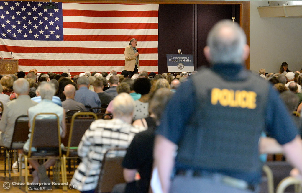 . Local police stand near the back of the room during a Town Hall meeting held by Congressman Doug LaMalfa at the Elks Lodge in Chico, Calif. Monday Aug. 7, 2017.  (Bill Husa -- Enterprise-Record)