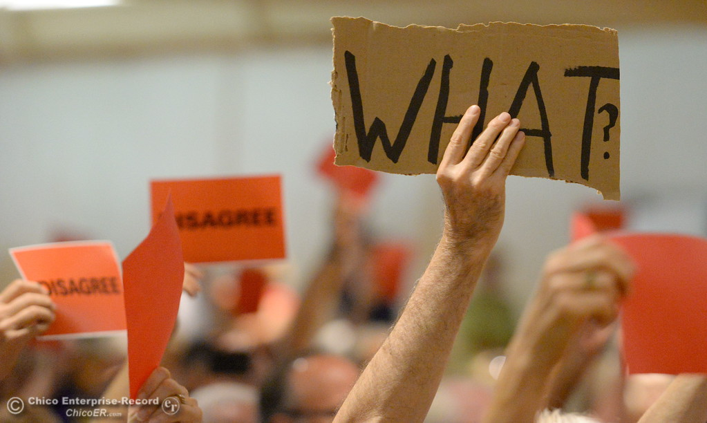 . Signs are held up during a Town Hall meeting held by Congressman Doug LaMalfa at the Elks Lodge in Chico, Calif. Monday Aug. 7, 2017.  (Bill Husa -- Enterprise-Record)