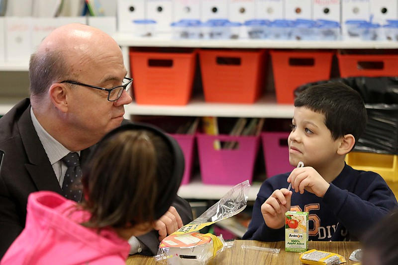 """Congressman Jim McGovern visited Frances Drake Elementary School in Leominster on Friday morning to get a look at how they  serve breakfast to the students because it is """"National School Breakfast Week."""" McGovern chats with first grade student Dereck Ortis-Torres, about his breakfasts during his visit. SENTINEL & ENTERPRISE/JOHN LOVE"""