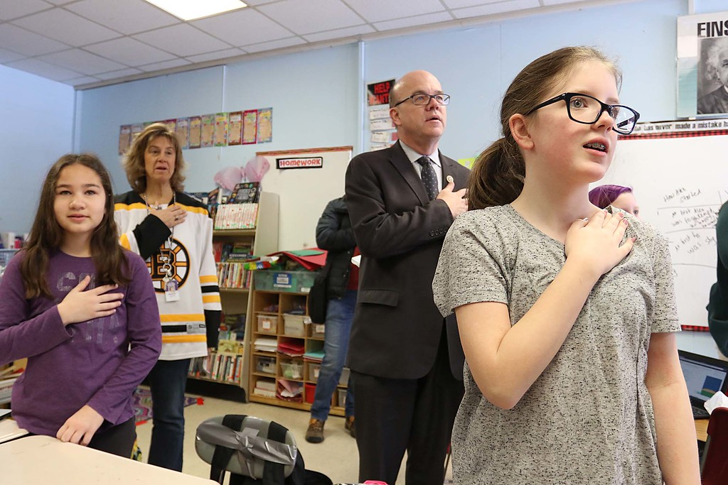 ". Congressman Jim McGovern visited Frances Drake Elementary School in Leominster on Friday morning to get a look at how they  serve breakfast to the students because it is ""National School Breakfast Week.\"" McGovern does the pledge of allegiance with the students in Julie Davis\'s fourth grade class about their lunches during his visit. From left is Vice Principal Wendy Hess with students Giana Colon and Madelyn Wilson doing the pledge with him. SENTINEL & ENTERPRISE/JOHN LOVE"