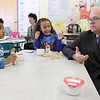 "Congressman Jim McGovern visited Frances Drake Elementary School in Leominster on Friday morning to get a look at how they  serve breakfast to the students because it is ""National School Breakfast Week."" McGovern chats with first graders Christopher Marte and Victoria Swift during his visit. SENTINEL & ENTERPRISE/JOHN LOVE"