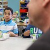 "Congressman Jim McGovern visited Frances Drake Elementary School in Leominster on Friday morning to get a look at how they  serve breakfast to the students because it is ""National School Breakfast Week."" First grade student Renaldo Alicea listens to McGovern during his visit. SENTINEL & ENTERPRISE/JOHN LOVE"