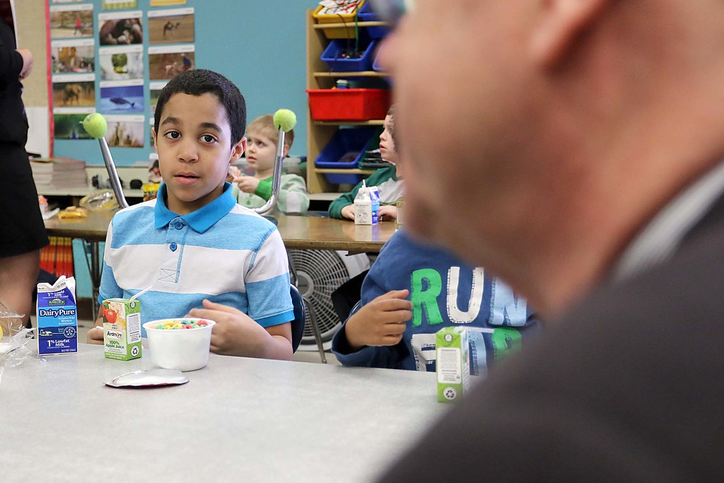 ". Congressman Jim McGovern visited Frances Drake Elementary School in Leominster on Friday morning to get a look at how they  serve breakfast to the students because it is ""National School Breakfast Week.\"" First grade student Renaldo Alicea listens to McGovern during his visit. SENTINEL & ENTERPRISE/JOHN LOVE"