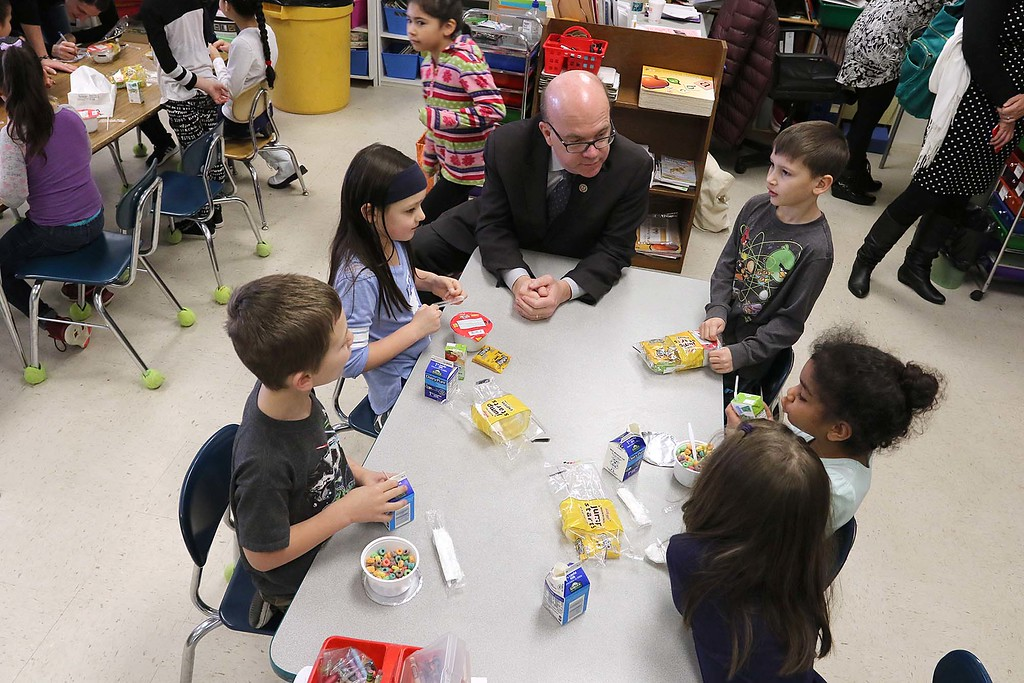 ". Congressman Jim McGovern visited Frances Drake Elementary School in Leominster on Friday morning to get a look at how they  serve breakfast to the students because it is ""National School Breakfast Week.\"" McGovern chats with first graders in Alyssa Sereafini\'s class about their lunches during his visit. SENTINEL & ENTERPRISE/JOHN LOVE"