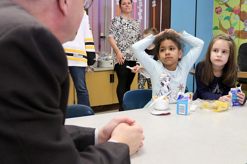 """Congressman Jim McGovern visited Frances Drake Elementary School in Leominster on Friday morning to get a look at how they  serve breakfast to the students because it is """"National School Breakfast Week."""" First grade students Nevaeh Kamataris and Melanie Sosa chat with McGovern about their breakfast during his visit. SENTINEL & ENTERPRISE/JOHN LOVE"""