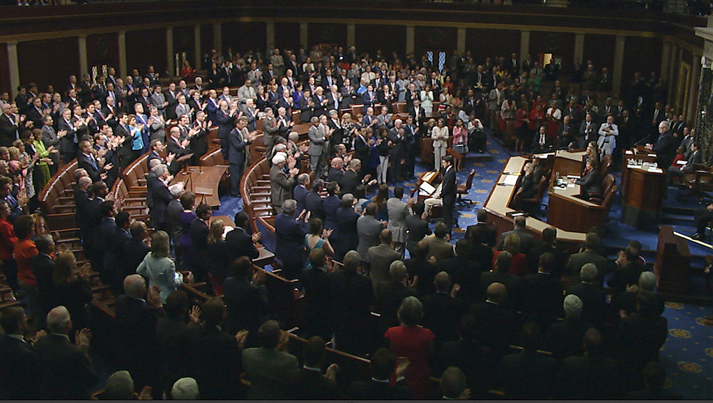 """. In this image from House Television video, House Speaker Paul Ryan of Wis., pauses as House members rise in applause Wednesday, June 14, 2017, on the House floor at the Capitol in Washington, about the shooting at the congressional baseball practice. Ryan said, \""""We are united in our anguish. An attack on one of us is an attack on all of us.\""""(House Television via AP)"""