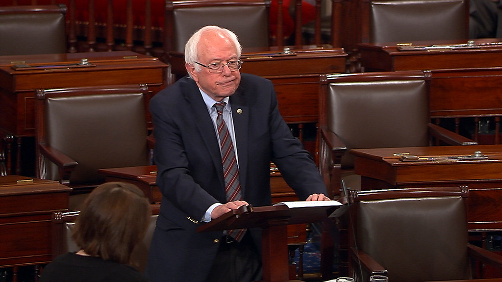 """. In this image from Senate Television video, Sen. Bernie Sanders, I-Vt., pauses as he speaks Wednesday, June 14, 2017, on the Senate floor at the Capitol in Washington, about the shooting at the Republican congressional baseball practice. Sanders says the man authorities identified as opening fire on the practice had apparently volunteered on his presidential campaign.  Sanders says in a statement: \""""I am sickened by this despicable act.\"""" (Senate Television via AP)"""