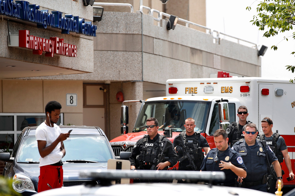 . Capitol Hill Police leave the emergency entrance at MedStar Washington Hospital Center in Washington, Wednesday, June 14, 2017, where House Majority Leader Steve Scalise of La. was taken after being shot in Alexandria, Va., during a Congressional baseball practice. (AP Photo/Jacquelyn Martin)