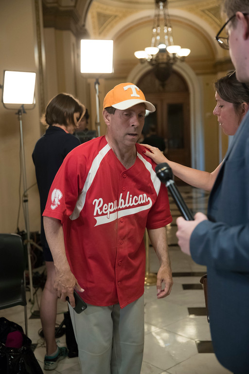 . Rep. Chuck Fleischmann, R-Tenn., still wearing his baseball uniform, describes to reporters on Capitol Hill in Washington, Wednesday, June 14, 2017,  the scene of a shooting at a congressional baseball game in Alexandria, Va. where House Majority Whip Steve Scalise of La., and others, where shot.   (AP Photo/J. Scott Applewhite)