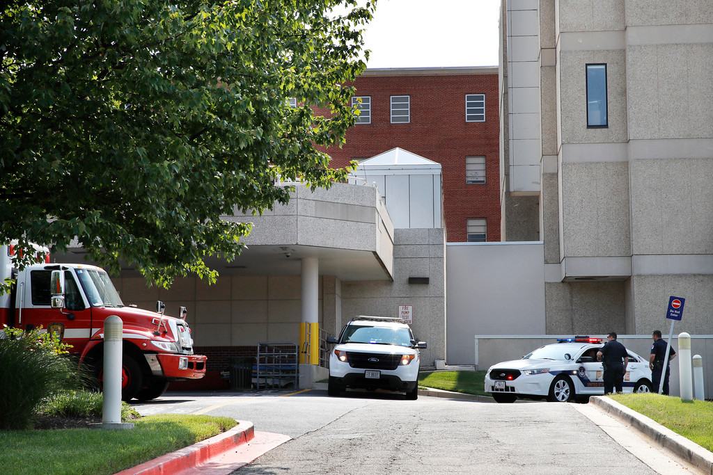 . Capitol Hill Police officers are posted outside the Emergency Room Ambulance exit at MedStar Washington Hospital Center in Washington, Wednesday, June 14, 2017, after House Majority Leader Steve Scalise of La. was shot during a Congressional baseball practice in Alexandria, Va. (AP Photo/Jacquelyn Martin)