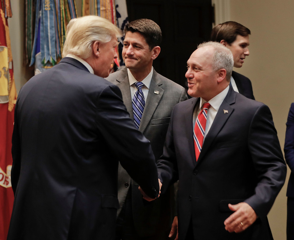 . FILE - In this June 6, 2017 file photo, President Donald Trump greets House Majority Whip Steve Scalise of La., accompanied by House Speaker Paul Ryan of Wis., before the start of a meeting with House and Senate Leadership in the Roosevelt Room of the White House in Washington. (AP Photo/Pablo Martinez Monsivais)