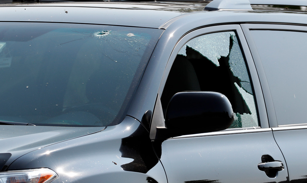 . A vehicle is seen with bullet holes in it at the scene of a shooting near a baseball field in Alexandria, Va., Wednesday, June 14, 2017, where House Majority Whip Steve Scalise of La. was shot at a congressional baseball practice. (AP Photo/Alex Brandon)
