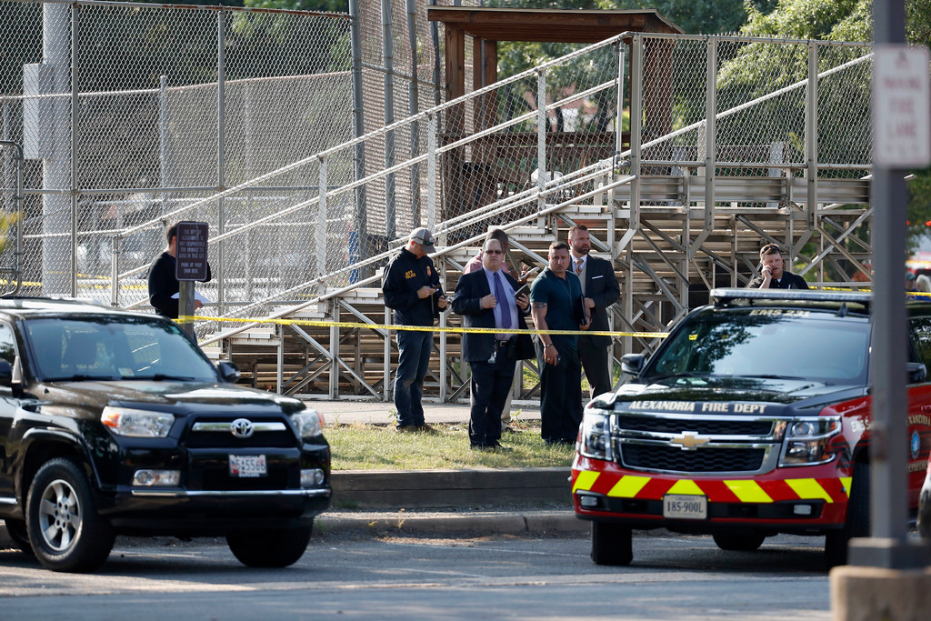 . Law enforcement officers investigate the scene of a shooting near a baseball field in Alexandria, Va., Wednesday, June 14, 2017, where House Majority Whip Steve Scalise of La. was shot at a Congressional baseball practice. (AP Photo/Alex Brandon)
