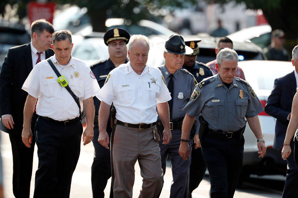 . Alexandria, Va. Police Chief Michael Brown, right, and others walk to speak to the media about the shooting in Alexandria, Va., Wednesday, June 14, 2017, where House Majority Whip Steve Scalise of La. was shot at a Congressional baseball practice.  (AP Photo/Alex Brandon)