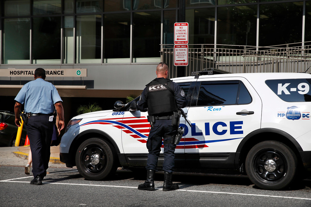 . A Metropolitan Police Officer with the K-9 Tactical Patrol is seen outside of the emergency entrance at George Washington University Hospital in Washington, Wednesday, June 14, 2017. (AP Photo/Jacquelyn Martin)