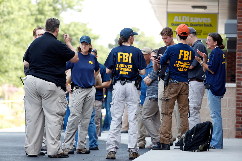 . Law enforcement officers gather near a shooting scene at baseball field in Alexandria, Va., Wednesday, June 14, 2017, where House Majority Whip Steve Scalise of La. was shot during a Congressional baseball practice.  (AP Photo/Alex Brandon)