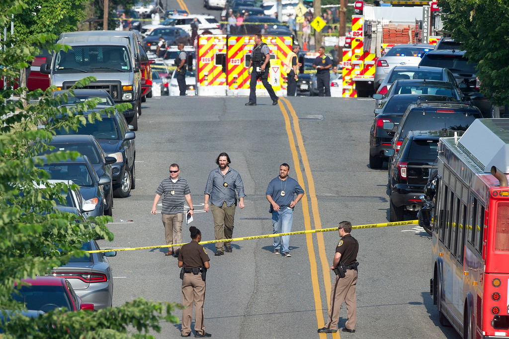 . Police and emergency personnel are seen near the scene where House Majority Whip Steve Scalise of La. was shot during a Congressional baseball practice in Alexandria, Va., Wednesday, June 14, 2017.  (AP Photo/Cliff Owen)
