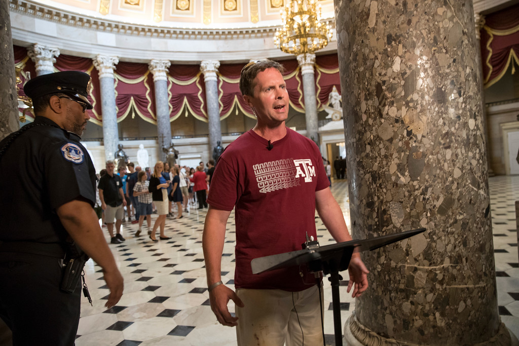 . Rep. Rodney Davis, R-Ill., still wearing his baseball shirt, describes for reporters on Capitol Hill in Washington, Wednesday, June 14, 2017, the scene at a congressional baseball practice in Alexandria, Va., earlier where a gunman opened fire wounding House Majority Whip Steve Scalise, R-La. during a Congressional baseball practice. (AP Photo/J. Scott Applewhite)
