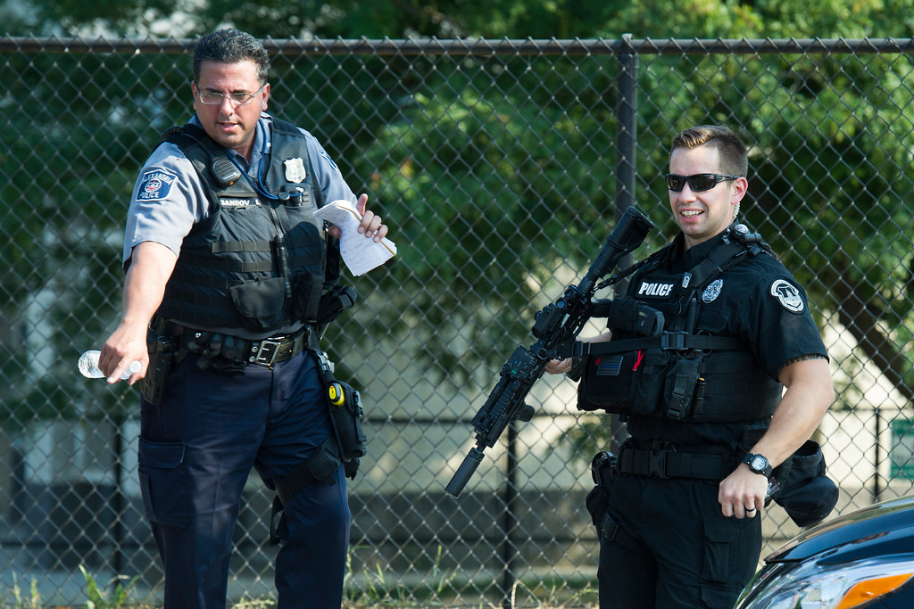 . Police stand watch at the sight of a multiple shooting in Alexandria, Va., Wednesday, June 14, 2017, involving House Majority Whip Steve Scalise of La. during a Congressional baseball practice. (AP Photo/Cliff Owen)