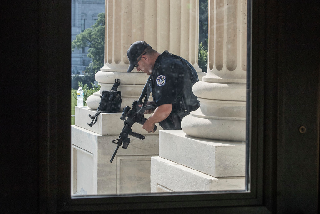 . A Capitol Hill Police officer stands his post at the entrance to the House of Representatives on Capitol Hill in Washington, Wednesday, June 14, 2017, after House Majority Whip Steve Scalise of La. was shot at a congressional baseball practice in Alexandria, Va.  (AP Photo/J. Scott Applewhite)