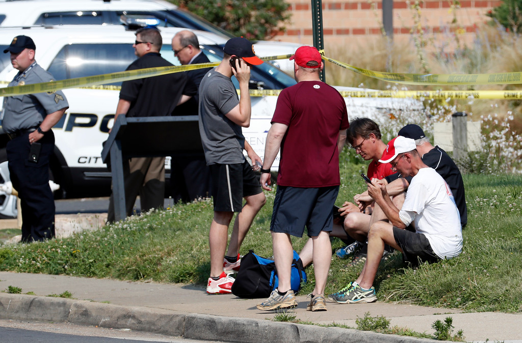 . People gather near the scene of a shooting near a baseball field in Alexandria, Va., Wednesday, June 14, 2017, where House Majority Whip Steve Scalise of La. was shot during a congressional baseball practice. (AP Photo/Alex Brandon)