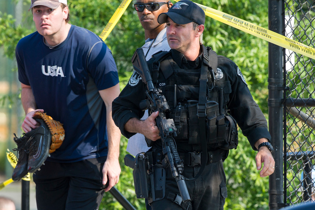 . A member of the Congressional Republican softball team is allowed to leave the scene of a multiple shooting involving House Majority Whip Steve Scalise of La., Wednesday, June 14, 2017, in Alexandria, Va. (AP Photo/Cliff Owen)