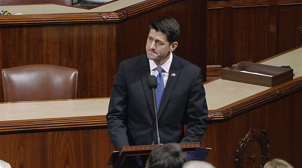 """. In this image from House Television video, House Speaker Paul Ryan of Wis., pauses as he speaks Wednesday, June 14, 2017, on the House floor at the Capitol in Washington, about the shooting at the congressional baseball practice. Ryan said, \""""We are united in our anguish. An attack on one of us is an attack on all of us.\""""(House Television via AP)"""